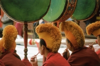 China, Szechuan (Sichuan), Kham region, Monks playing drums at Temple Puja. - Jill Gocher