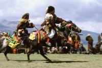 China, Szechuan (Sichuan), Kham region, Khampa horsemen show off their skills at the summer nomad festival. - Jill Gocher