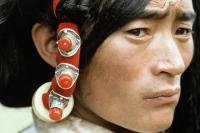 China, Szechuan (Sichuan), Kham region, A Khampa man wears traditional hair decorations. - Jill Gocher