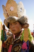 China, Szechuan (Sichuan), Kham region, Lama wearing traditional decorations. - Jill Gocher