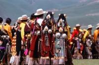 China, Szechuan (Sichuan), Kham region, Khampa men and women in full traditional costume at one of the festivals. - Jill Gocher