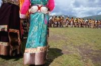 China, Szechuan (Sichuan), Kham region, Khampa men and women in full traditional costumes at the summer nomad festival. - Jill Gocher