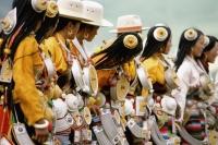 China, Szechuan (Sichuan), Kham region, Khampa women in full traditional costume at one of the festivals. - Jill Gocher