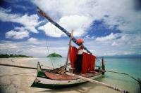 Indonesia, Lombok, Fisherman tending nets on beach - Jill Gocher