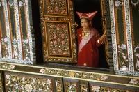 Indonesia, Sumatra West, girl in traditional Minangkabau dress in traditional house - Jill Gocher