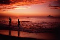 Indonesia, Sulawesi, Manado, Sunset on beach at Bunaken Island. - Jill Gocher