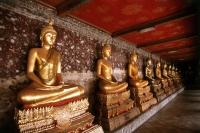 Thailand, Bangkok, Wat Suthat, Row of Buddhas. - James Marshall