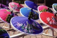 Thailand, Hand painted umbrellas drying in the sun. - James Marshall