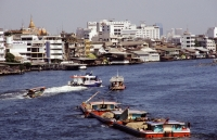 Thailand, Bangkok, Barges on river. - James Marshall