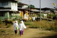 Muslim girls walking home. - Steve Raymer