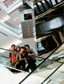 Group of friends on escalator. - Jack Hollingsworth
