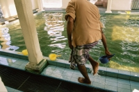 Malaysia, Penang, Indian Muslim washing his feet in a ritual of ablution before prayers at the Kapitan Kling Mosque. - Steve Raymer