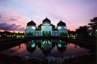 Indonesia, Aceh, Banda Aceh, sunset behind Baiturrahman Great Mosque. - Steve Raymer