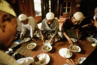 Cambodia, Phnom Penh, Muslims celebrating the return of pilgrims with a meal of rice and curry. - Steve Raymer
