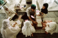 Indonesia, Aceh, Banda Aceh, students meet in small groups to learn the Koran with a tutor at the Baiturrahman Great Mosque. - Steve Raymer
