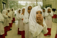 Malaysia, Kuala Lumpur, young children praying together at an Islamic kindergarten at the National Mosque. - Steve Raymer