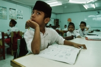 Malaysia, Kuala Lumpur, young Muslim boy in class at the National Mosque. - Steve Raymer