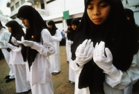 Indonesia, Jakarta, Muslim students offering prayers and ask for blessings on their country. - Steve Raymer