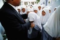 Indonesia, Jakarta, Muslim students kissing hand of Rector Noer Muhammad Iskandar, as a sign of respect. - Steve Raymer