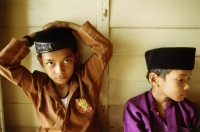 Malaysia, Kota Bharu, Young boys in traditional garb waiting for their Koran reading class to begin. - Steve Raymer