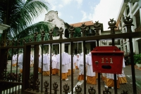 Singapore, students assemble inside gates of the Madrasah Alsagoff Al-Arabiyah (school). - Steve Raymer