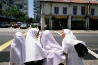 Singapore, students wait for a bus after finishing classes at Madrasah Alsagoff Al-Arabiyah (school). - Steve Raymer