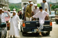 Thailand, Worshippers dress in traditional garb arrive for Friday prayers in the back of a pickup truck. - Steve Raymer