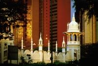 Malaysia, Kuala Lumpur, Domes and archways of the Kuala Lumpur Railway Station contrast skyline. - Steve Raymer