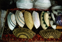 Singapore, Embroidered prayer caps (called songkoks) are piled high at a store near the Sultan Mosque. - Steve Raymer