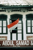Singapore, an Arab Street shop flies a Singapore flag on National Day (August 9). - Steve Raymer