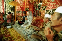 Indonesia, a Muslim cleric reading from the Koran to bind bride and groom in marriage. - Steve Raymer