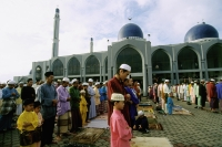 Malaysia, Kota Bharu, Fathers and sons standing in neat rows at Kubang Kerian Mosque during Friday prayers. - Steve Raymer