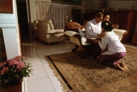 Indonesia, in front of her family and close friends, Wati bowing before her father, Sutadi Suparlan to ask permission to marry. - Steve Raymer