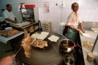Singapore, Men preparing food in one of the many stalls along Arab Street. - Steve Raymer
