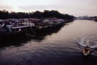 Brunei Darussalam, Borneo, A boat speeding along the river. - Steve Raymer