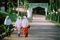 Malaysia, Johor Bahru, Muslim girls walking down a street. - Steve Raymer
