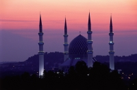 Malaysia, Shah Alam, Sultan Salahuddin Abdul Aziz Shah Mosque at sunset. - Steve Raymer