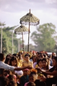 Indonesia, Lombok, a bride walking under a canopy and accompanied by female attendants, following musicians to the groom's home. - Steve Raymer