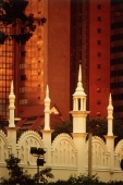 Malaysia, Kuala Lumpur, Spires of an old railway station rise against modern buildings. - Steve Raymer