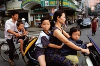 Vietnam, Ho Chi Minh City, Motorcycles and bicycles are used as an efficient means of transportation throughout Vietnam. - Steve Raymer