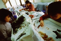 Vietnam, Hoi An, Women in a shop embroidering tapestries. - Steve Raymer