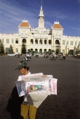 Vietnam, Ho Chi Minh City, A man selling newspapers on the street. - Steve Raymer