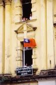 Myanmar (Burma), Yangon (Rangoon), Flag in windowsill of old colonial building. - Steve Raymer