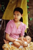 Myanmar (Burma), Yangon (Rangoon), Mother and child, streetscene. - Steve Raymer