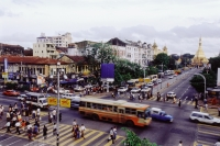 Myanmar (Burma), Yangon (Rangoon), Busy intersection, views of old colonial buildings. - Steve Raymer