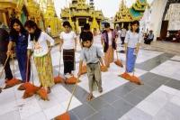 Myanmar (Burma), Yangon (Rangoon), Group of young adults and children helping to clean at Shwedagon Pagoda. - Steve Raymer