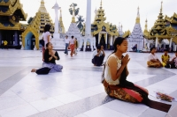 Myanmar (Burma), Yangon (Rangoon), People praying at the Shwedagon Pagoda. - Steve Raymer