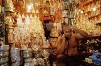 Myanmar (Burma), Yangon (Rangoon), Monk tending shop at the Shwedagon Pagoda. - Steve Raymer