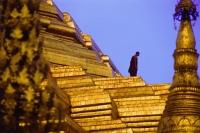 Myanmar (Burma), Yangon (Rangoon), A monk walking amidst the spires of the Shwedagon Pagoda. - Steve Raymer