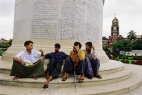 Myanmar (Burma), Yangon (Rangoon), Young men sitting at the base of the Independence Monument in Yangon. - Steve Raymer